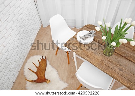 Beautiful interior with table and chairs - stock photo