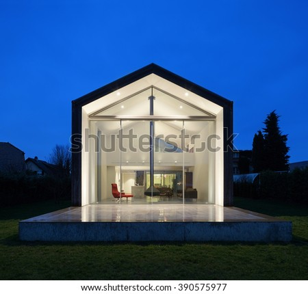 beautiful interiors of a modern house, view from exterior