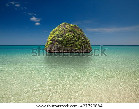 Beautiful island with a palm tree at ocean, Thailand - stock photo