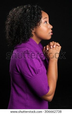 Beautiful isolated african american woman praying - stock photo