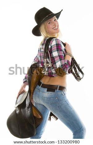 beautiful isolated cowgirl with stirrup iron and saddle - stock photo