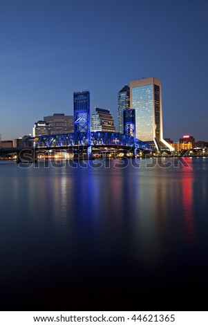Beautiful Jacksonville, Florida skyline with reflections in St. John's River at twilight - stock photo