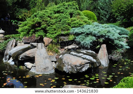 Beautiful Japanese garden with fish pond - stock photo