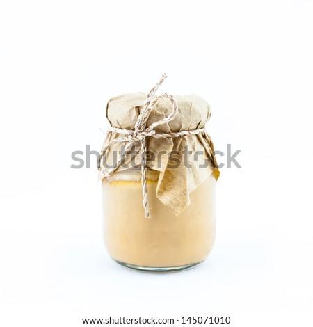 Beautiful Jar of custard isolated on white background. - stock photo