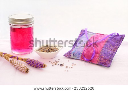 Beautiful jewel toned lavender jelly with lavender wands and sachet in vertical format - stock photo