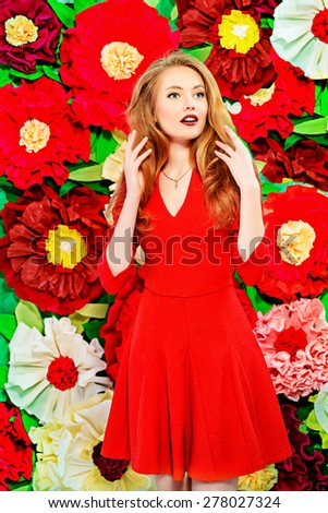 Beautiful joyful young woman with magnificent blonde hair posing on a background of bright large flowers. Beauty, fashion. The spirit of summer. - stock photo