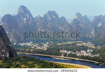 Beautiful karst mountains and the Li River. View from the hill above town of the Hingping - China