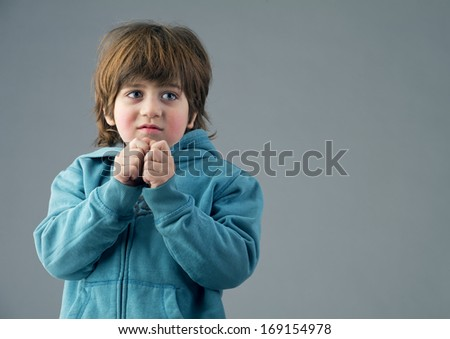 Beautiful kid having a thought isolated