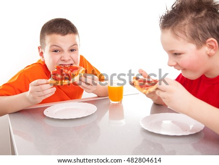 Beautiful kids eat pizza.