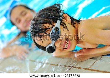 Beautiful kids in pool - stock photo