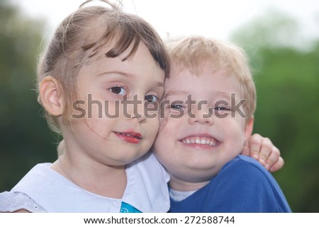 Beautiful kids sister and brother together in park
