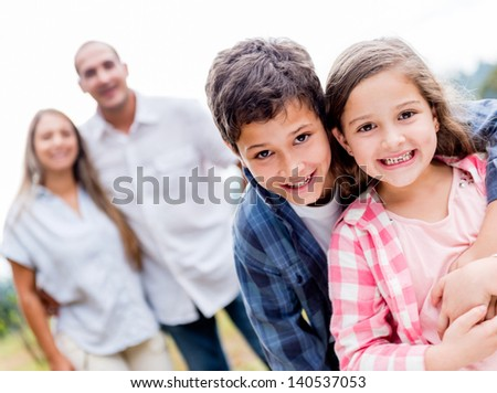 Beautiful kids with their family looking happy outdoors