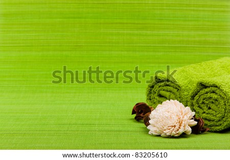 beautiful kit for spa and aromatherapy on a green background - stock photo