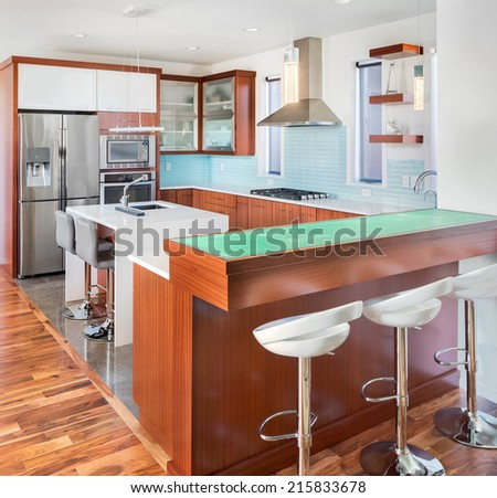 Beautiful Kitchen and Bar in New Luxury Home - stock photo