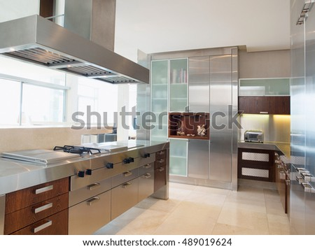 Beautiful kitchen interior in new luxury home. Luxurious kitchen with stainless steel appliances