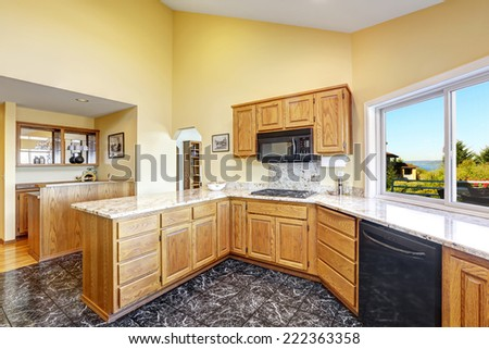 Beautiful kitchen room with high vaulted ceiling black granite tile floor and granite tops