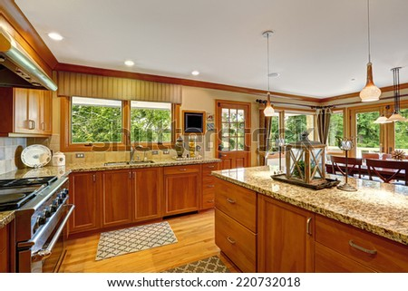 Beautiful kitchen storage combination with granite tops and decorated kitchen island - stock photo