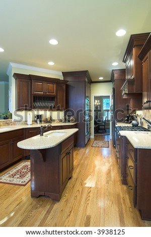 beautiful kitchen with top of the line cabinets and counters