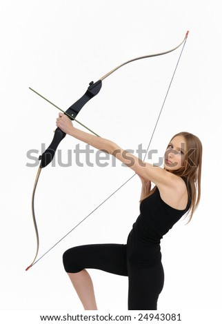 Beautiful kneeling woman aiming with bow and arrow