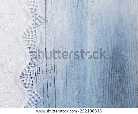 beautiful lace on the blue wooden background - stock photo