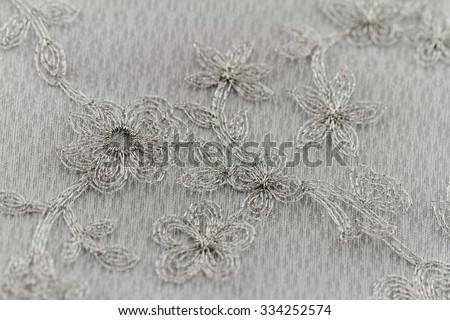 Beautiful lace with flower pattern - macro photo - stock photo