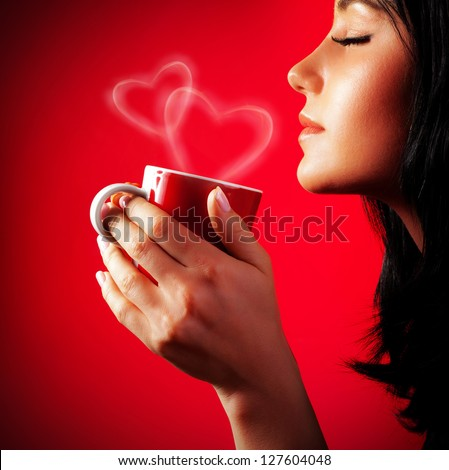 Beautiful lady drinking coffee, brunette enjoy cup of hot chocolate, side view cute girl isolated on red background, portrait of female with morning tea, gorgeous woman holding cappuccino mug - stock photo