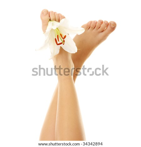Beautiful lady feet with madonna lily in spa - Spa concept