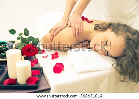 Beautiful lady having a relaxing massage in a beauty saloon. Beauty and body care concept - stock photo