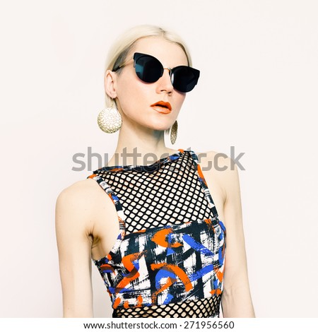 Beautiful Lady in fashionable Sunglasses. Trend of the season - stock photo