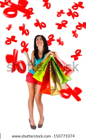 Beautiful lady looking upwards with shopping bags in her hands - isolated on white.