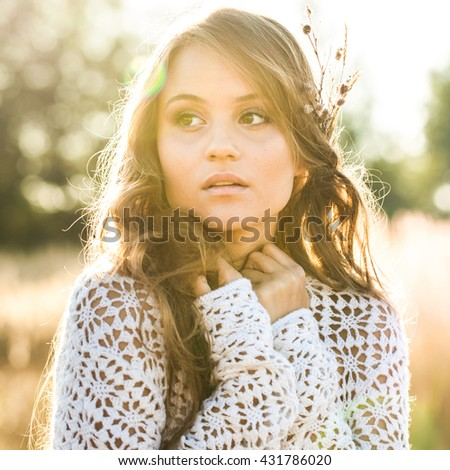 Beautiful lady model in open field at sunrise - close up outdoors shot - stock photo