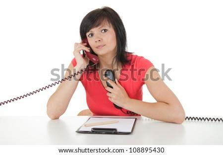 beautiful lady secretary speaking on the phones, white background - stock photo