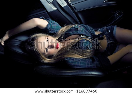 Beautiful lady sitting in a  car - stock photo
