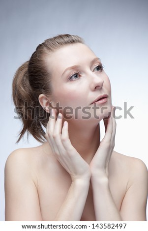 beautiful lady touching her face with both hands