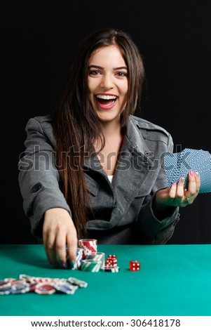 Beautiful lady wiining blackjack game at casino