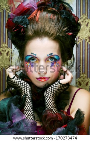 Beautiful lady with artistic make-up.Doll style.