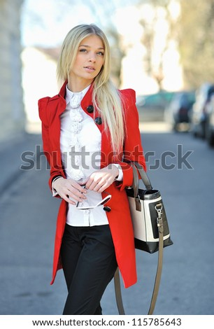 Beautiful lady with bag after shopping
