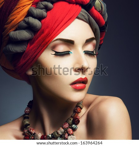 Beautiful lady with colored turban - stock photo