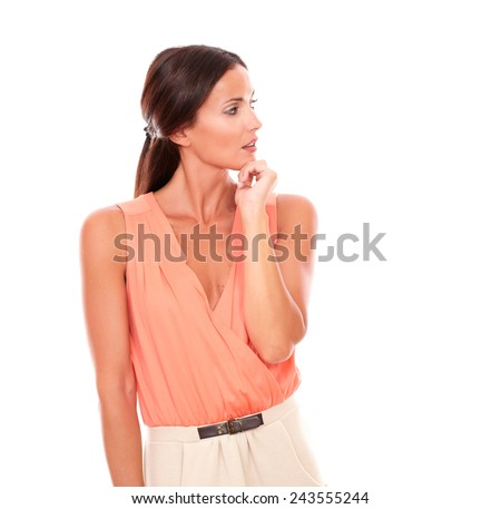 Beautiful lady with hand on chin wondering about a question while looking to her left in white background - copyspace - stock photo
