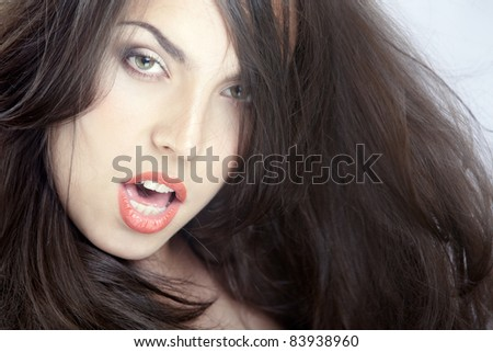 Beautiful lady with perfect makeup and blown hairs. Studio photo