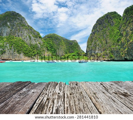 Beautiful lagoon and old wooden pier at Phi Phi Ley island  - stock photo