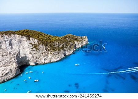 Beautiful lagoon with caves and boats in blue water - stock photo