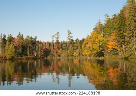 Beautiful Lake autumn view of tree reflections in the water - stock photo
