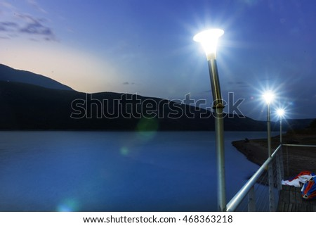 beautiful lake between kosovo and albania in front of led lights