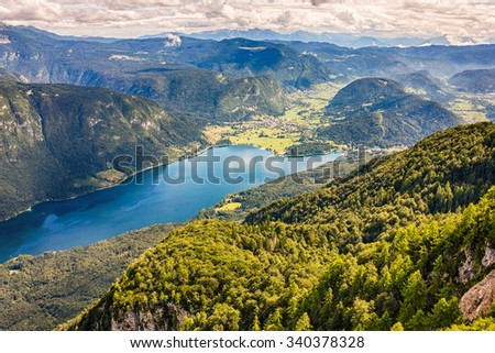 Beautiful Lake Bohinj surrounded by mountains of Triglav national park. view from Vogel cable car top station, Slovenia - stock photo