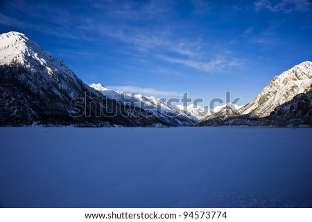 beautiful lake sunrise landscape in tibet with blue sky and wonderful cloud - stock photo