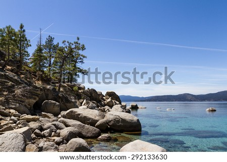 Beautiful Lake Tahoe with chemtrails across the blue sky