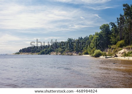 Beautiful lake, view from the water. Forest on the shore.
