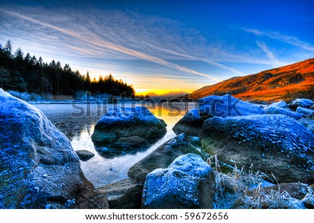 beautiful lake view with mountain range and sunset - stock photo