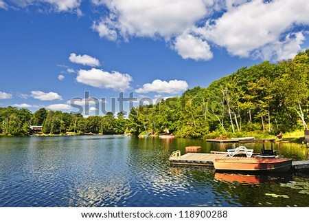 Beautiful lake with docks in Ontario Canada cottage country - stock photo